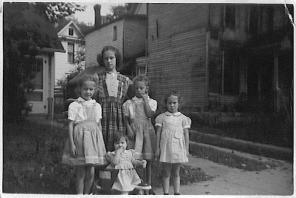 Sue, Ann, Barb, Grace, Rica 1944. Dr. Daniel's (our great-grandfather) house is to the right.