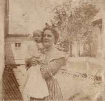 Grace Daniel Applegate (Bobbie) holding her first son, G. W. Applegate III (Uncle Pud), summer of 1900.