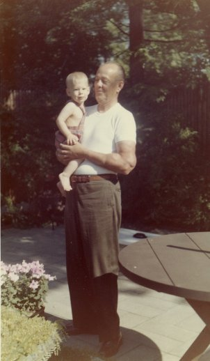 Uncle Pud (G. W. Applegate III) holding grandson Mark.