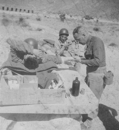 Ted, Army photo, Feb. 16, 1943, removing a 2 inch splinter at field 1st aid station; far West Texas.